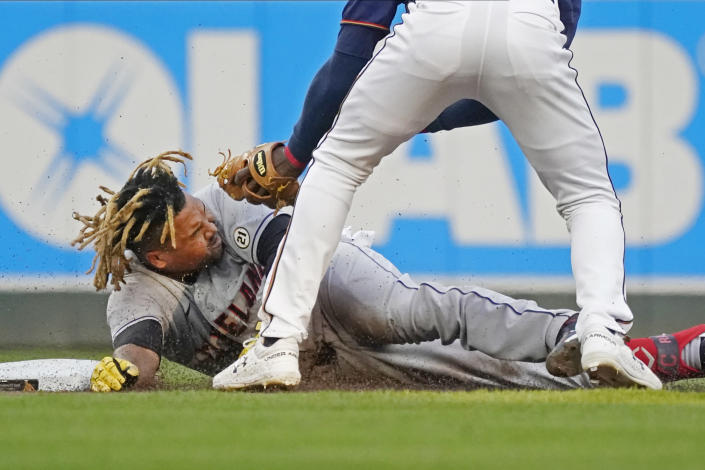 Cleveland Indians' Jose Ramirez lies on the base path after being tagged out, trying to stretch a single into a double, by Minnesota Twins shortstop Nick Gordon during first inning of a baseball game Wednesday, Sept. 15, 2021, in Minneapolis. (AP Photo/Jim Mone)