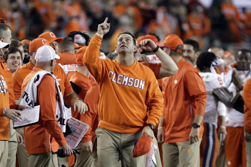 FILE - In this Jan. 7, 2019, file photo, Clemson head coach Dabo Swinney celebrates in the final seconds of the NCAA college football playoff championship game against Alabama, in Santa Clara, Calif. For the first time, the defending national champion Tigers are No. 1 in The Associated Press preseason Top 25 presented by Regions Bank, Monday, Aug. 19, 2019. (AP Photo/David J. Phillip, File)