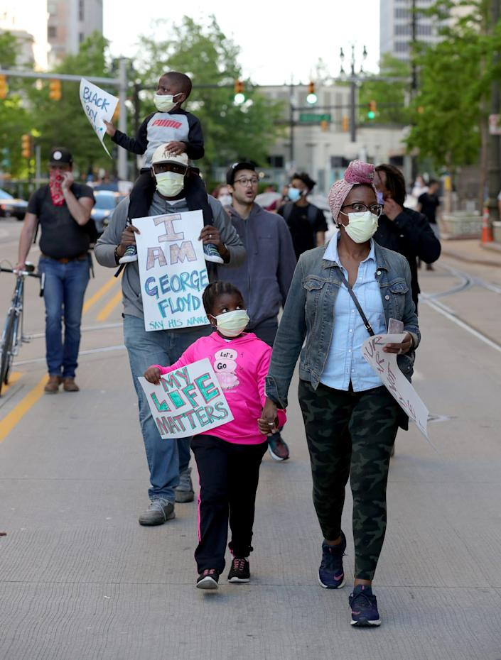 Nick Symonette and son Nick Symonett III, daughter Nadia and wife Nateesan march in Detroit last summer after George Floyd's murder by a police officer in Minneapolis.