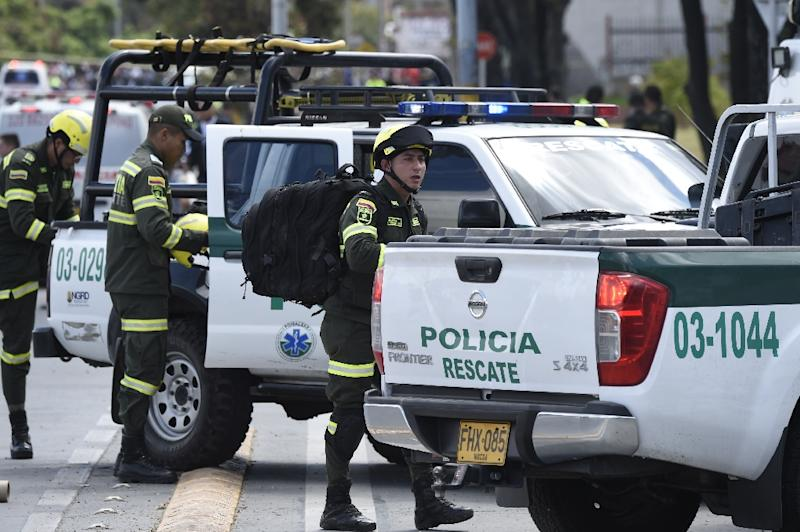 Security forces work at the site of a car bombing at a police cadet training school in Bogota (AFP Photo/JUAN BARRETO                        )