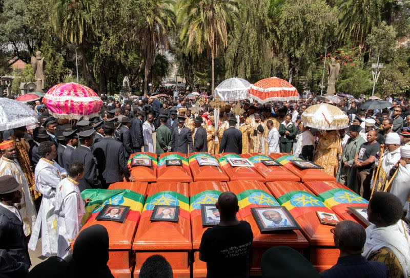 Pallbearers and other people attend the burial ceremony of the Ethiopian Airline Flight ET 302 crash victims at the Holy Trinity Cathedral Orthodox church in Addis Ababa
