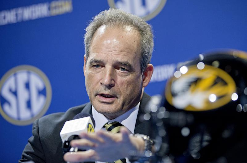 Missouri head coach Gary Pinkel speaks at a press conference ahead of Saturday's Southeastern Conference championship college football game against Auburn, Friday, Dec. 6, 2013, in Atlanta. (AP Photo/David Goldman)