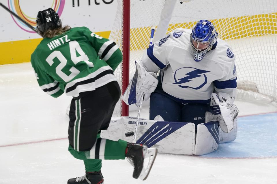 Dallas Stars left wing Roope Hintz (24) has his shot blocked by Tampa Bay Lightning goaltender Andrei Vasilevskiy (88) in the third period of an NHL hockey game in Dallas, Tuesday, March 2, 2021. (AP Photo/Tony Gutierrez)