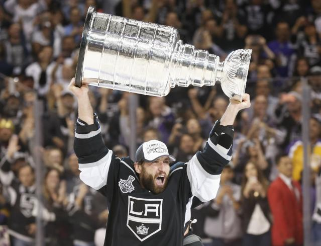 Los Angeles Kings' Jarrett Stoll celebrates with the Stanley Cup after the Kings' defeated the New York Rangers in Game 5 of their NHL Stanley Cup Finals hockey series in Los Angeles, California, June 13, 2014. REUTERS/Lucy Nicholson (UNITED STATES - Tags: SPORT ICE HOCKEY)