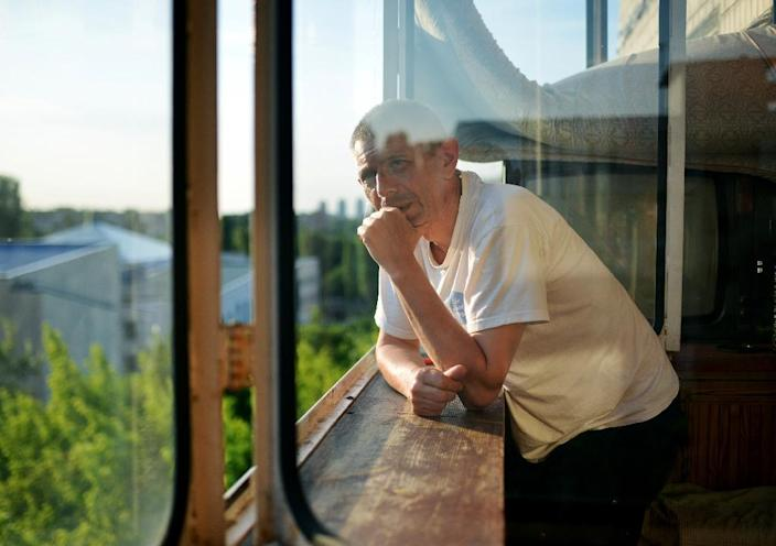 Ukrainian man Andrei, 52, standing on the balcony of a refuge home in Kiev, after he fled the separatist east out of fear for his life for being gay (AFP Photo/Genya Savilov)