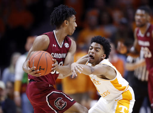 Tennessee guard Jalen Johnson (13) attempts to steal the ball from South Carolina guard A.J. Lawson (00) during the first half of an NCAA college basketball game Wednesday, Feb. 13, 2019, in Knoxville, Tenn. (AP photo/Wade Payne)