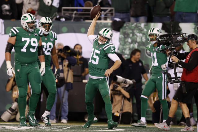 New York Jets quarterback Josh McCown (15) spikes the ball after scoring on a touchdown run against the Buffalo Bills during the first half of an NFL football game, Thursday, Nov. 2, 2017, in East Rutherford, N.J. (AP Photo/Kathy Willens)