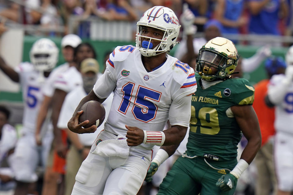 Florida quarterback Anthony Richardson (15) gets past South Florida linebacker Brian Norris (29) on an 80-yard touchdown run during the second half of an NCAA college football game Saturday, Sept. 11, 2021, in Tampa, Fla. (AP Photo/Chris O'Meara)