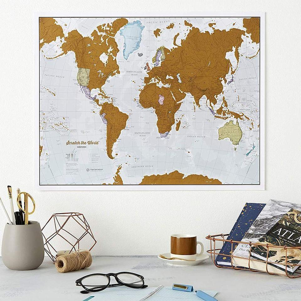 """<p><strong>Maps International</strong></p><p>amazon.com</p><p><strong>$19.99</strong></p><p><a href=""""https://www.amazon.com/dp/B07K31PFJ9?tag=syn-yahoo-20&ascsubtag=%5Bartid%7C2141.g.29518657%5Bsrc%7Cyahoo-us"""" rel=""""nofollow noopener"""" target=""""_blank"""" data-ylk=""""slk:Shop Now"""" class=""""link rapid-noclick-resp"""">Shop Now</a></p><p>The jetsetter in her is always talking about traveling the world. Now she can pinpoint all the places she wants to go and document the countries she's already been. This scratch-off map has a pretty gold film over each country and state. She just needs a coin to scratch and reveal the colorful places underneath. </p>"""