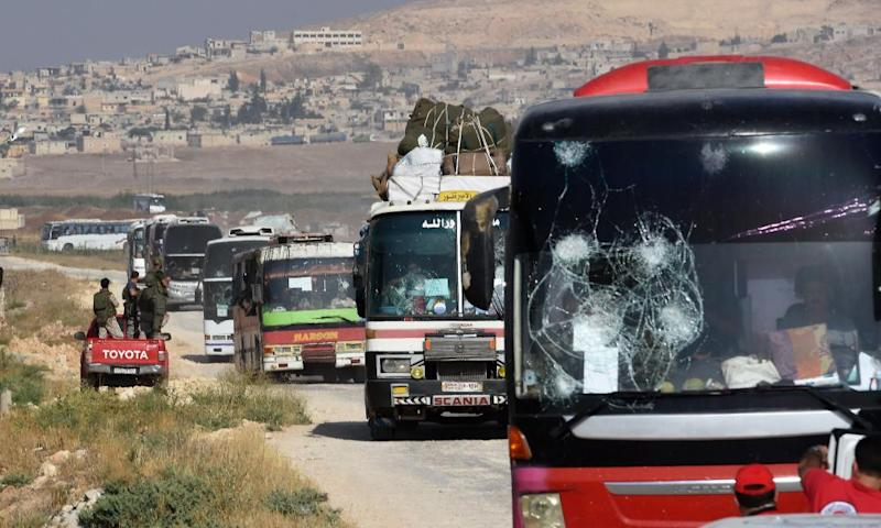Buses transporting residents and fighters from the towns of Fua and Kefraya