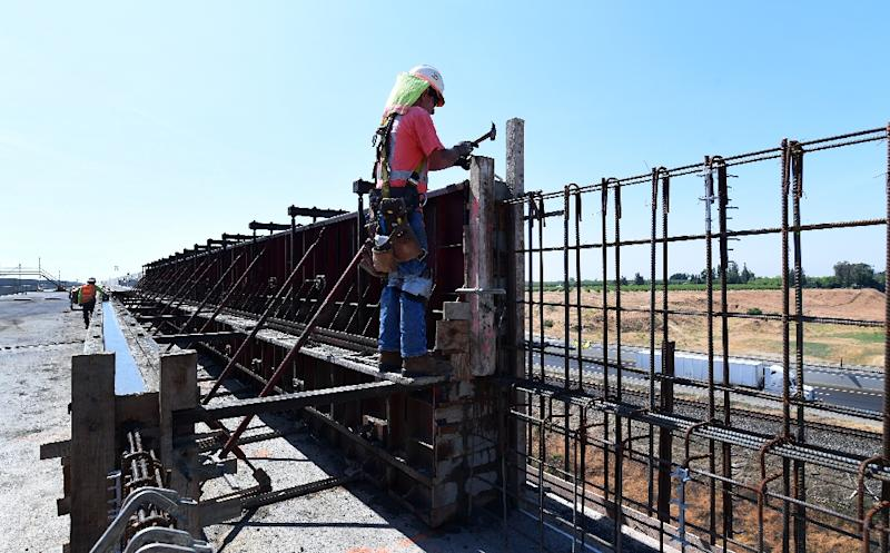 A construction crew works on the San Joaquin River viaduct portion of the high-speed railway in Fresno, California, on May 8, 2019 (AFP Photo/Frederic J. BROWN)