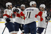 Florida Panthers celebrate after left wing Mike Hoffman, left, scored against the Vegas Golden Knights during the first period of an NHL hockey game Thursday, Feb. 28, 2019, in Las Vegas. (AP Photo/John Locher)