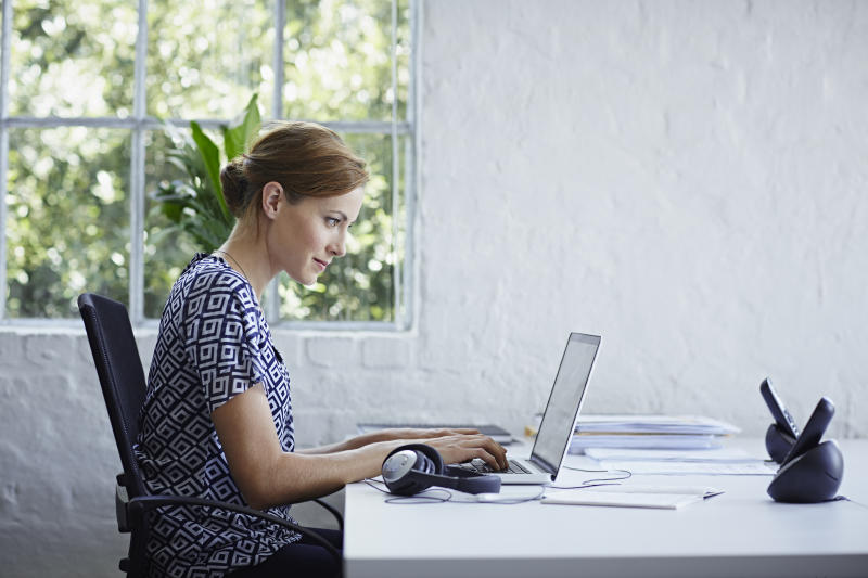 Woman working on computer replying to emails