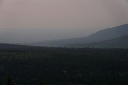 A general view of the skyline obscured by smoke taken from the Glen Alps trailhead of Chugach State Park in Anchorage