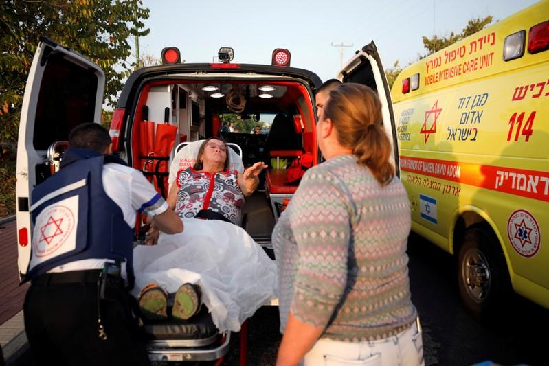 An injured woman is evacuated to hospital after a rocket was fired from Gaza into Israel, in Ashkelon, southern Israel