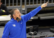 Kentucky head coach John Calipari yells instructions to players in the first half of an NCAA college basketball game against North Carolina, Saturday, Dec. 19, 2020, in Cleveland. (AP Photo/Tony Dejak)