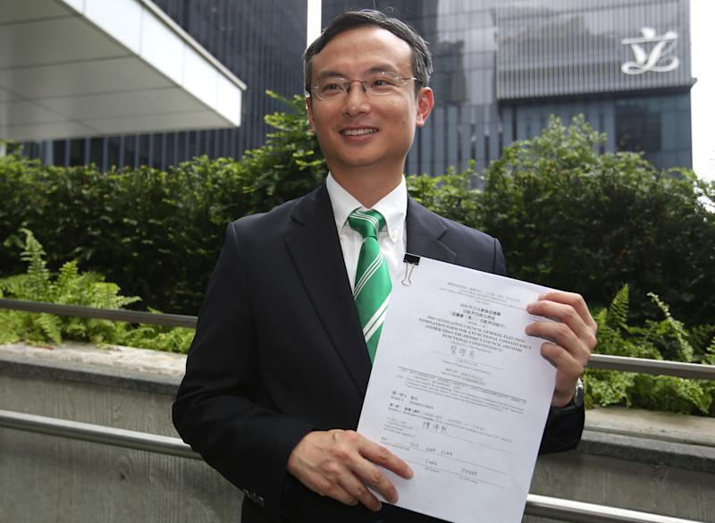 Dr Pierre Chan Pui-yin, former president of the Public Doctors' Association, submits his application to run in the Legco election outside CGO in Tamar. 26JUL16 SCMP / Edward Wong (Photo by Edward Wong/South China Morning Post via Getty Images)