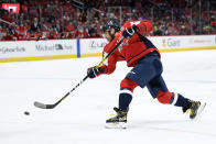 Washington Capitals left wing Alex Ovechkin (8), of Russia, takes a shot during the first period of an NHL hockey game against the Tampa Bay Lightning, Saturday, Dec. 21, 2019, in Washington. (AP Photo/Nick Wass)