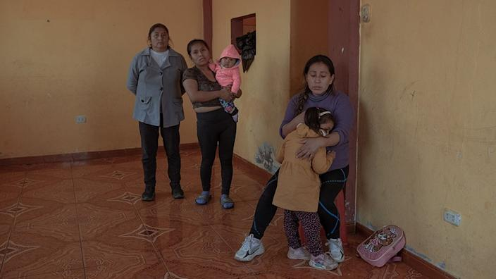 Cinthia Estrada Bolivar (31) and her 3 year old daughter, in their house accompanied by their relatives