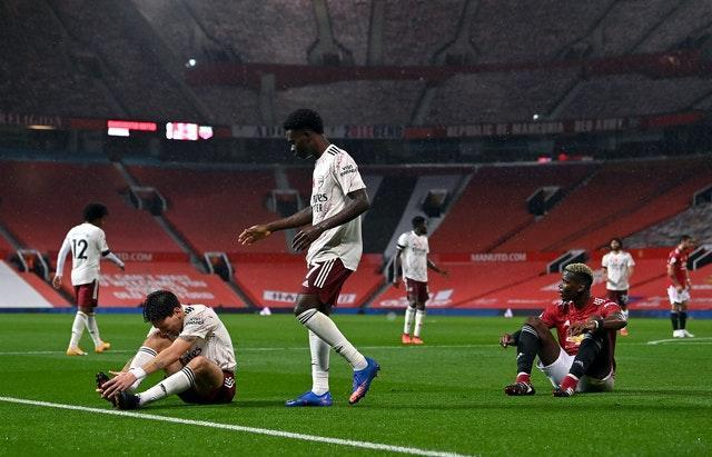 Paul Pogba, right, gave away the penalty with a foul on Hector Bellerin, left,