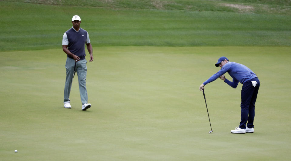 Rory McIlroy, right, reacts to missing a putt on the third hole as Tiger Woods, left, looks on during fourth round play at the Dell Technologies Match Play Championship golf tournament, Saturday, March 30, 2019, in Austin, Texas. (AP Photo/Eric Gay)
