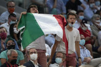 Italian tennis lovers support Italy's Matteo Berrettini playing Serbia's Novak Djokovic during their quarterfinal match of the French Open tennis tournament at the Roland Garros stadium Wednesday, June 9, 2021 in Paris. (AP Photo/Michel Euler)