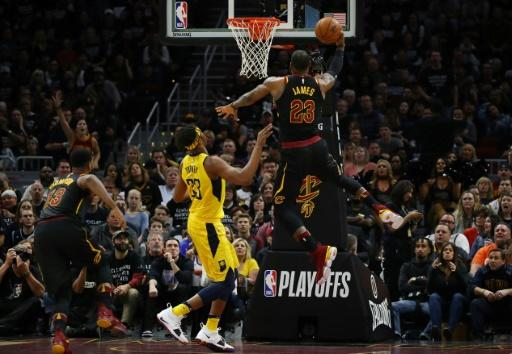 LeBron James of the Cleveland Cavaliers (R) drives around Myles Turner of the Indiana Pacers