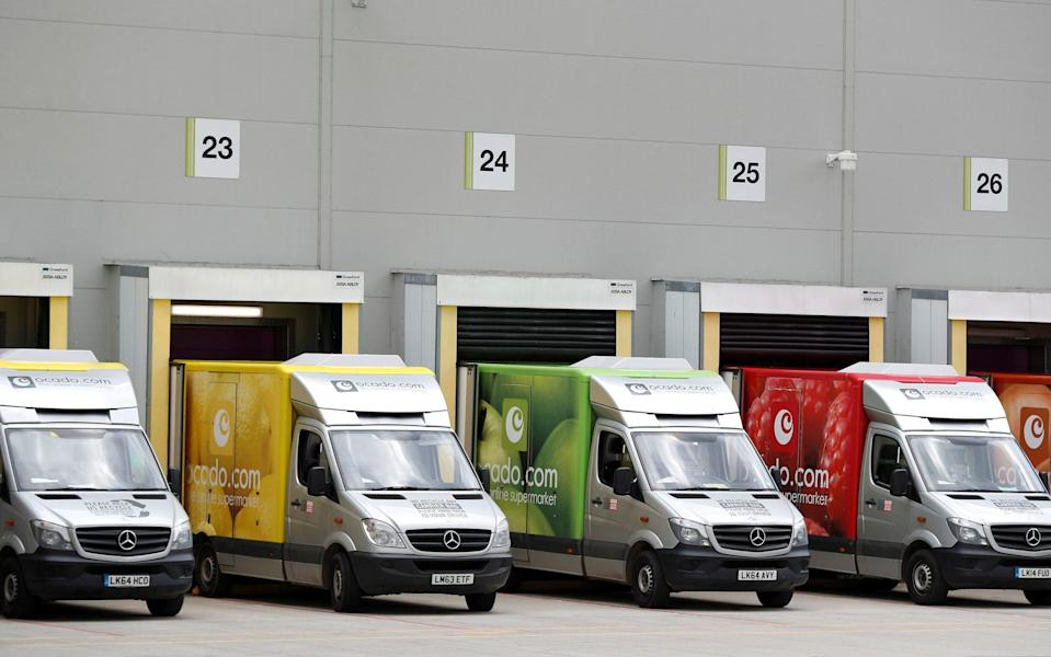 Delivery vans are lined up prior to dispatch at the Ocado Customer Fulfilment Centre in Andover - Peter Nicholls /REUTERS