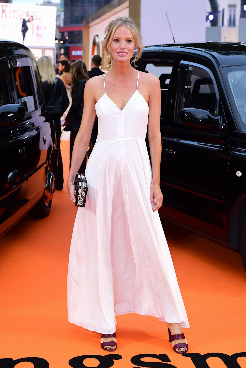 <p>The German model opted for a pure white floor length dress by Deitas.<br><i>[Photo: PA]</i> </p>