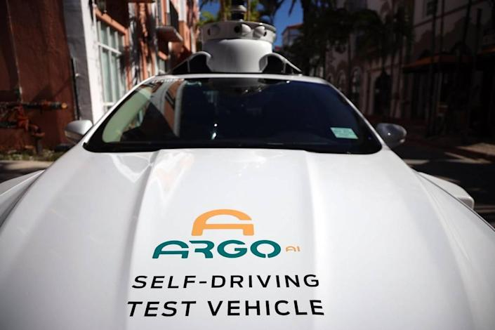 Experimental autonomous vehicle arrives on Espanola Way for a drop-off on Tuesday, December 8, 2020. Ford and its technology partner Argo AI are using their experimental autonomous vehicles to deliver school supplies and fresh greens to Miami Dade Schools families.