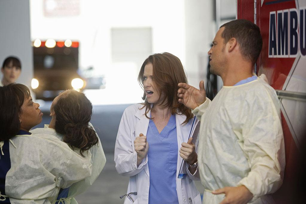 """GREY'S ANATOMY - """"Free Falling"""" - In the first hour, """"Free Falling"""" (9:00-10:00 p.m.), the fifth-year residents return for the first day of a year that will make or break their careers: Meredith faces the consequences of tampering with Derek's clinical trial and is terminated at the hospital; April tries to step up to the plate as Chief Resident in the wake of a giant sinkhole in the middle of Seattle; and Cristina and Owen are still at odds over their drastically different feelings for their unborn child. """"Grey's Anatomy"""" returns for its eighth season with a two-hour event THURSDAY, SEPTEMBER 22 (9:00-11:00 p.m., ET) on the ABC Television Network. (ABC/RANDY HOLMES) CHANDRA WILSON, SANDRA OH, SARAH DREW, JUSTIN CHAMBERS Grey's Anatomy"""