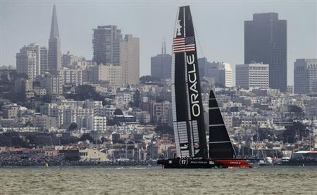 Oracle Team USA sails against the city skyline against Emirates Team New Zealand during Race 3 of the 34th America's Cup yacht sailing race in San Francisco, California September 8, 2013. REUTERS/Robert Galbraith