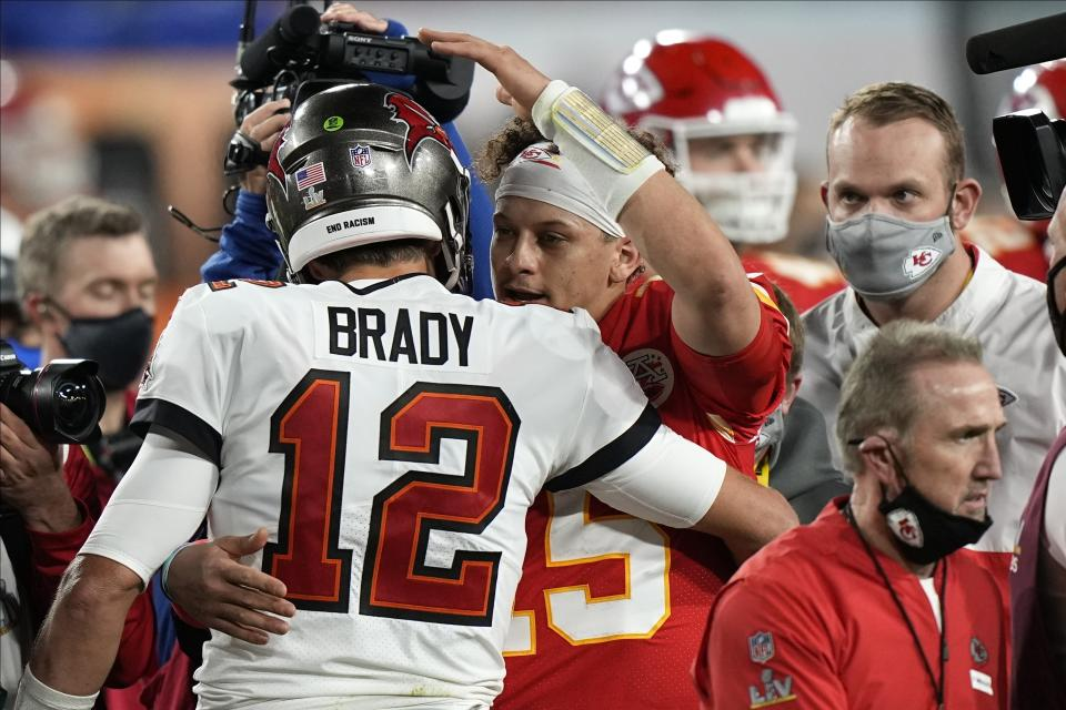 Tom Brady and Patrick Mahomes occupy the top two spots on the NFLPA's yearly player sales list. (AP Photo/David J. Phillip)