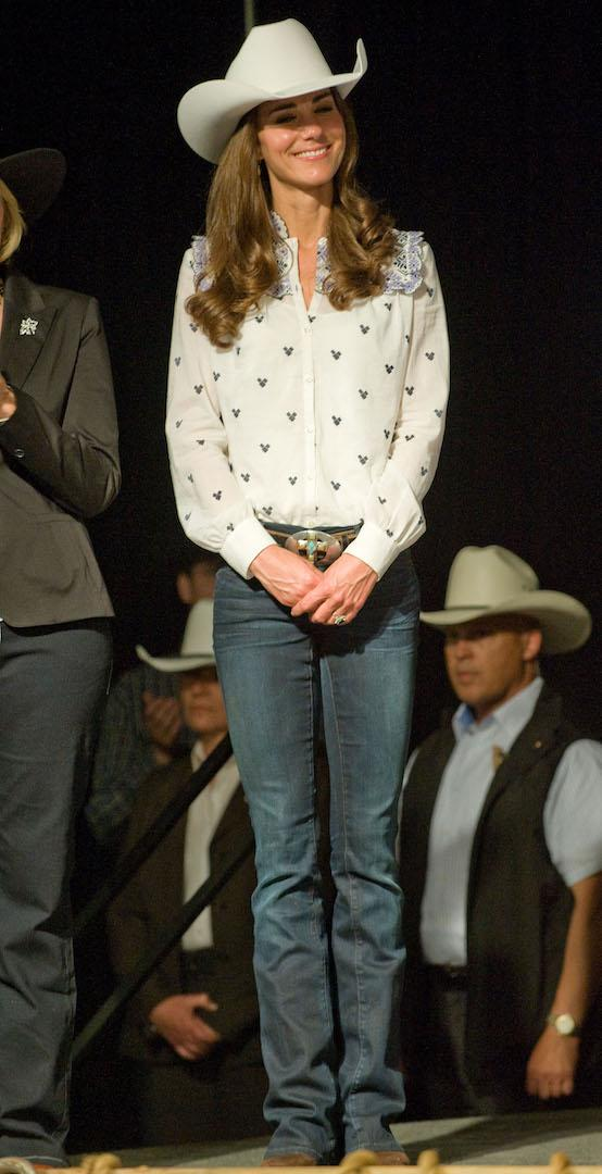 The Duchess of Cambridge got into the spirit of the rodeo while in Calgary on her first post-wedding tour in a cowboy hat gifted to her by a local company. An Alice Temperley shirt and pair of £285 Passion bootcut jeans by GoldSign completed the look. <em>[Photo: Getty]</em>