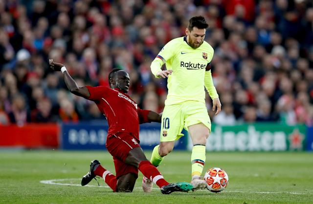 Liverpool's Sadio Mane (left) and Barcelona's Lionel Messi (right) battle for the ball.