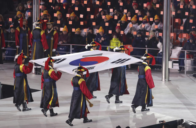 <p>The South Korea flag is carried into the arena during the opening ceremony of the 2018 Winter Olympics in Pyeongchang, South Korea, Friday, Feb. 9, 2018. (AP Photo/Michael Sohn) </p>