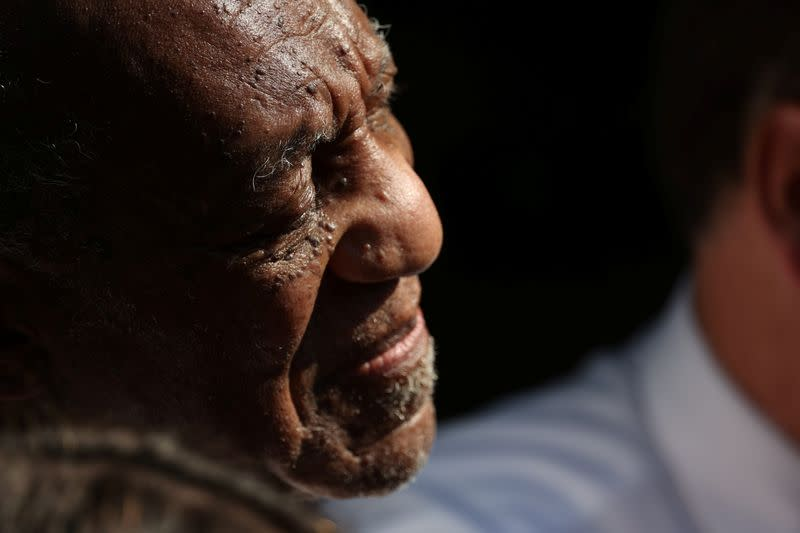 Bill Cosby reacts outside his house after Pennsylvania's highest court overturned his sexual assault conviction and ordered him released from prison immediately, in Elkins Park