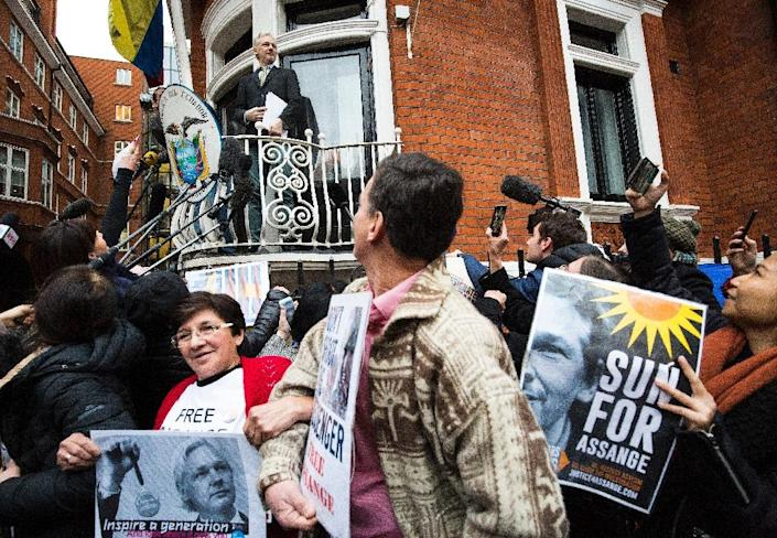 Wikileaks founder Julian Assange, pictured addressing supporters from the Ecuadorian embassy, fears he could be extradited from Sweden to the US where he could face a long prison sentence (AFP Photo/Jack Taylor)