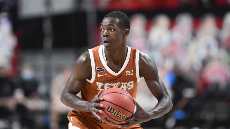 Texas' Andrew Jones (1) controls the ball during the second half of an NCAA college basketball game against Texas Tech in Lubbock, Texas, Saturday, Feb. 27, 2021. (AP Photo/Justin Rex)