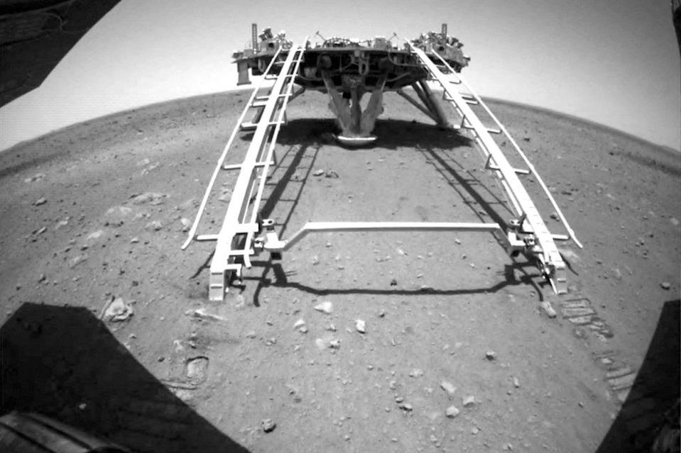Chinese rover Zhurong of the Tianwen-1 mission drives down the ramp of the lander onto the surface of Mars, in this screenshot taken from a video released by China National Space Administration (CNSA) on 22 May 2021