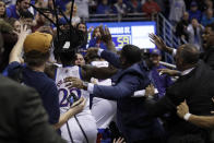 A fight between players spills into the crowd during the second half of an NCAA college basketball game between Kansas and Kansas State in Lawrence, Kan., Tuesday, Jan. 21, 2020. Kansas defeated Kansas State 81-59. (AP Photo/Orlin Wagner)