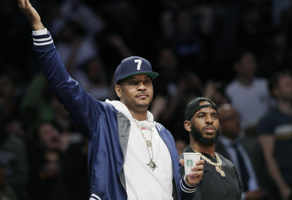 Carmelo Anthony is among friends in his return to the NBA. (AP Photo/Kathy Willens)