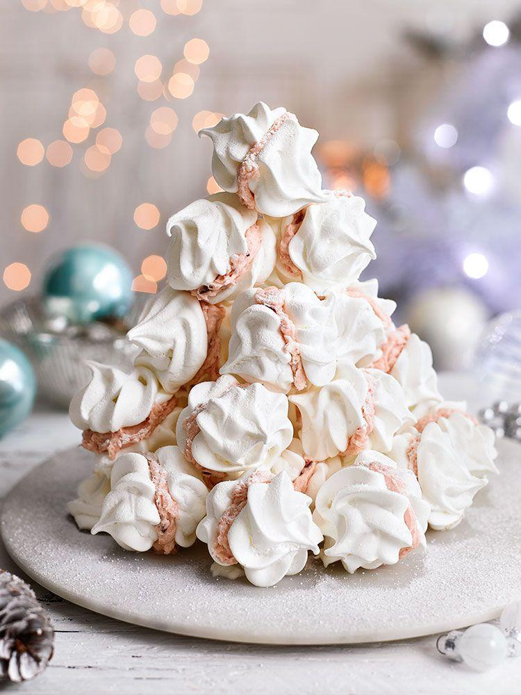 """<p>A tower of these meringues will look stunning on your Christmas table</p><p><strong>Recipe: <a href=""""https://www.goodhousekeeping.com/uk/christmas/christmas-recipes/a558381/meringue-kiss-tower/"""" rel=""""nofollow noopener"""" target=""""_blank"""" data-ylk=""""slk:Meringue kiss tower"""" class=""""link rapid-noclick-resp"""">Meringue kiss tower</a></strong></p>"""