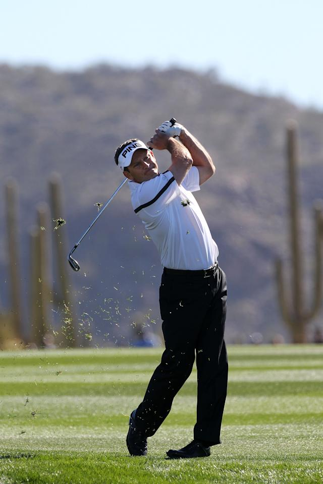 MARANA, AZ - FEBRUARY 25:  Mark Wilson of the United States hits an approach shot on the first hole during the quarterfinal round of the World Golf Championships-Accenture Match Play Championship at the Ritz-Carlton Golf Club on February 25, 2012 in Marana, Arizona.  (Photo by Sam Greenwood/Getty Images)