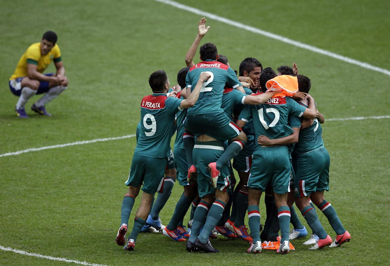 Mexico players celebrate winning the gold medal during the men's soccer final against Brazil at the 2012 Summer Olympics, Saturday, Aug. 11, 2012, in London. (AP Photo/Andrew Medichini)