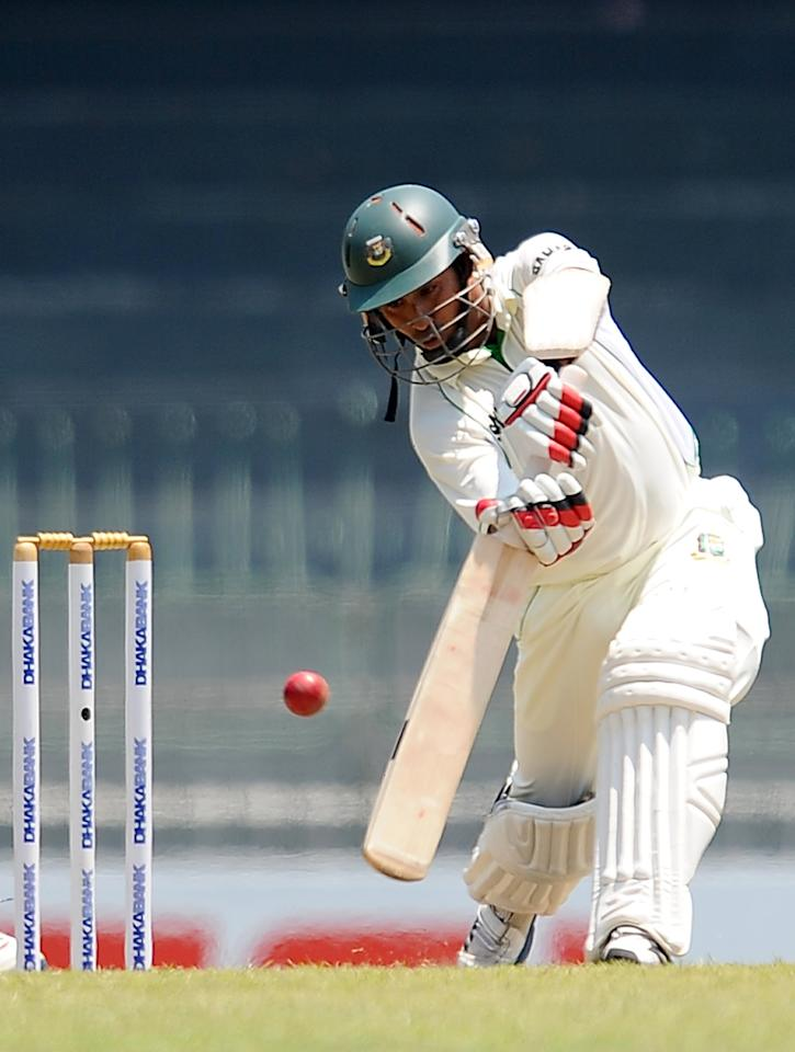 Bangladeshi cricketer Mohammad Ashraful plays a shot during the opening day of their second Test cricket match between Sri Lanka and Bangladesh at the R. Premadasa Cricket Stadium in Colombo on March 16, 2013.  AFP PHOTO/ LAKRUWAN WANNIARACHCHI