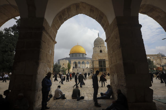 """Muslims gather for Friday prayer, next to the Dome of the Rock Mosque in the Al Aqsa Mosque compound in Jerusalem's old city, Friday, Nov. 6, 2020. The Palestinian leadership has condemned the United Arab Emirates' decision to forge ties with Israel as a """"betrayal,"""" but it could lead to a tourism bonanza for Palestinians in east Jerusalem as Israel courts wealthy Gulf travelers. (AP Photo/Mahmoud Illean)"""