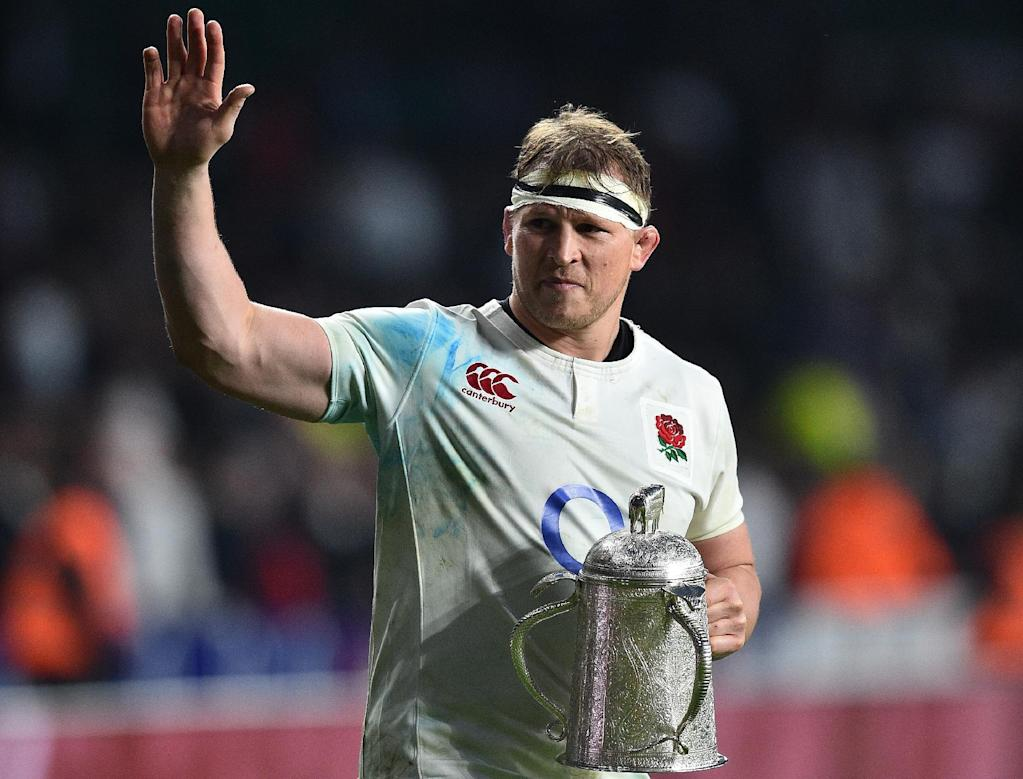 England's Dylan Hartley holds the Calcutta Cup trophy as leaves the pitch atfter winning the Six Nations international rugby union match against Scotland at Twickenham stadium in south west London on March 11, 2017 (AFP Photo/Glyn KIRK                          )