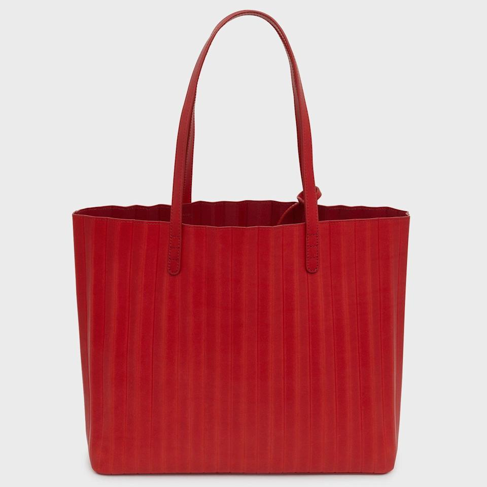 """<p><strong>Mansur Gavriel</strong></p><p>mansurgavriel.com</p><p><strong>$695.00</strong></p><p><a href=""""https://go.redirectingat.com?id=74968X1596630&url=https%3A%2F%2Fwww.mansurgavriel.com%2Fproducts%2Fbrandy-pleated-tote-avion&sref=https%3A%2F%2Fwww.harpersbazaar.com%2Ffashion%2Ftrends%2Fg22591832%2Fbest-laptop-bags-for-women%2F"""" rel=""""nofollow noopener"""" target=""""_blank"""" data-ylk=""""slk:Shop Now"""" class=""""link rapid-noclick-resp"""">Shop Now</a></p><p>Mansur's pleated, buttery leather tote is a timeless option—and a nice way to add a pop of color to your look. </p>"""