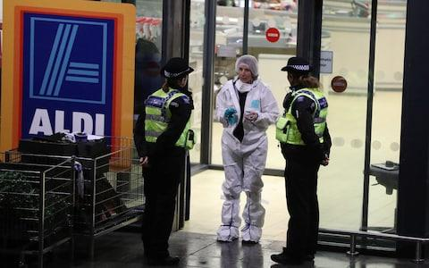 Forensic officers at the scene of a fatal stabbing in Aldi supermarket, Skipton - Credit: Ben Lack